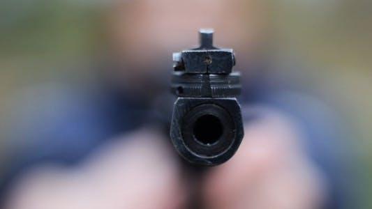 Thumbnail for Male Lifting A Gun