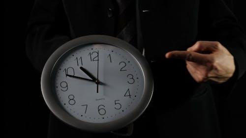 Businessman Shows Time On Clock (black)