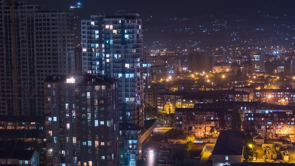 Thumbnail for Multistorey Buildings with Changing Window Lighting At Night in City. Timelapse
