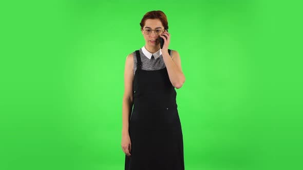 Thumbnail for Funny Girl in Round Glasses Is Angrily Talking for Mobile Phone, Green Screen