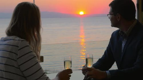 Couple on romantic date at seaside cafe