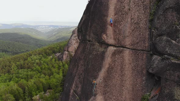 Two Climbers Make the Ascent on the Vertical Wall.