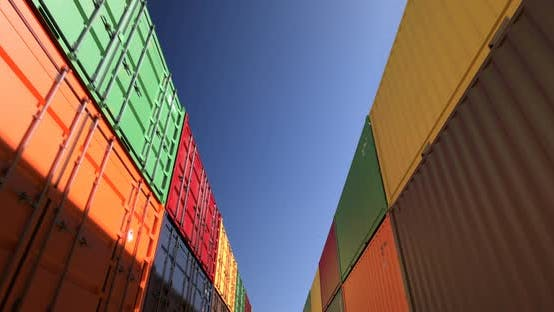 Thumbnail for Rows of Shipping Containers Under Clear Sky Seamless Loop