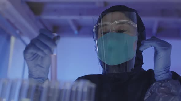 Thumbnail for Female Asian Biochemist Working with Samples