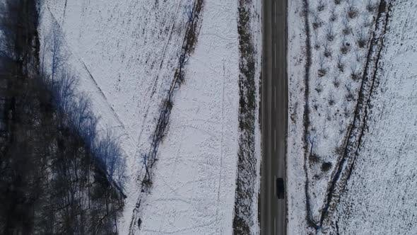 Cover Image for Aerial View Driving Car On A Road