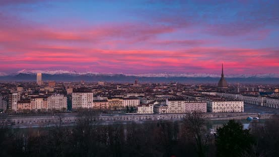 Thumbnail for Timelapse twilight to sunrise over Turin Italy, town wake up, colorful dramatic sky