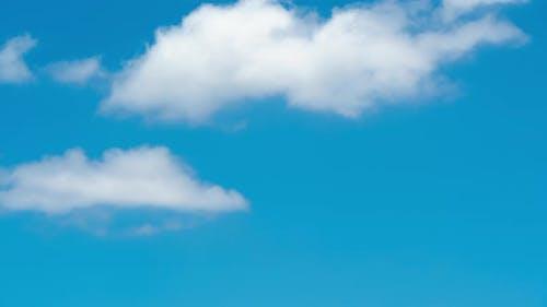 Clouds blowing in wind