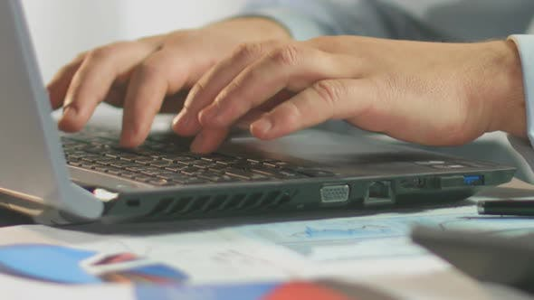 Thumbnail for Businessman Typing Weekly Report on Laptop Computer, Close-Up of Male Hands