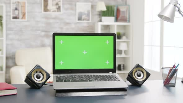 Thumbnail for Laptop with Green Screen on the Table in Bright and Well Lit Living Room Space