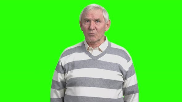 Angry Old Man with Frown Face Blames You.