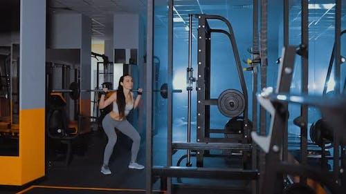 Girl Squats with a Barbell