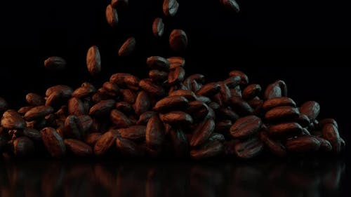 Coffee Beans Falling On The Table On A Dark Background