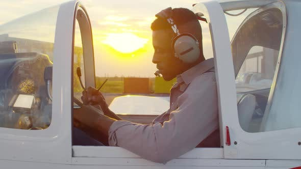 Thumbnail for Man in Headset Sitting in Pilot Cabin