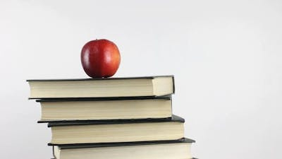 Books And Apple as Symbol of Knowledge Rotating