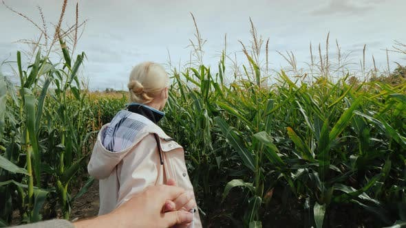 Thumbnail for A Young Woman Farmer Invites You To Visit the Corn Maze By Following the Hand Behind Her