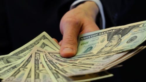 Extending Hand with Dollars