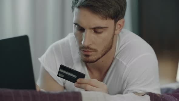 Thumbnail for Man Using Credit Card for Online Payment on Computer. Technology Purchase
