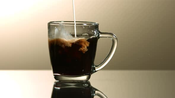 Thumbnail for Milk poured into coffee in ultra slow motion 1500fps - COFFEE w MILK