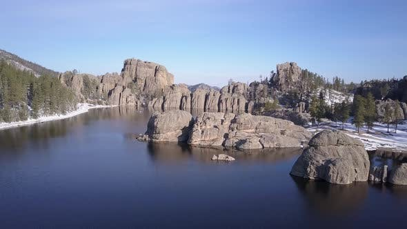 Thumbnail for Aerial Flyover of Lake or Pond Reservoir Impoundment in Black Hills Western North America Forest