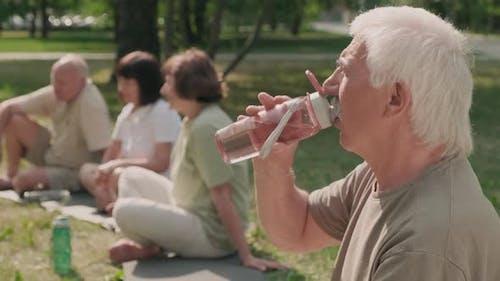 Senior Man on Outdoor Yoga Classes