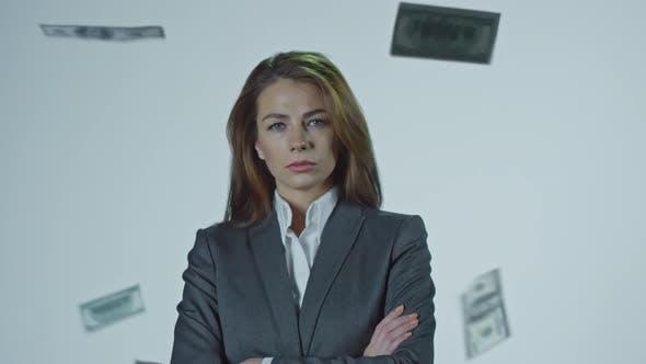 Thumbnail for Money Falling on Serious Businesswoman