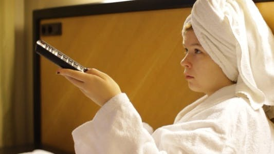 Thumbnail for Woman Watching TV in Hotel Room