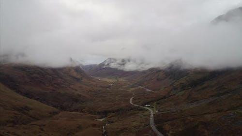 Aerial Pedestal Shot of Fog Over Glencoe Valley Scotland