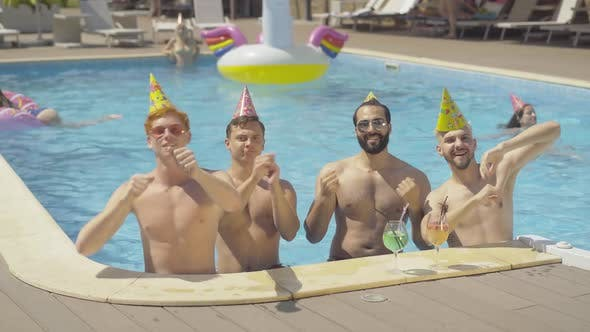 Thumbnail for Group of Cheerful Multiethnic Male Friends Dancing in Pool at Resort. Portrait of Happy Young Middle