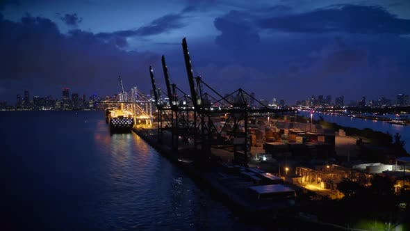 Thumbnail for Night Shot of Port Miami Against the Backdrop of a Stormy Sky and City Panorama.