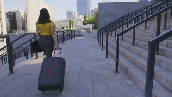 Thumbnail for Back View Asian Business Woman with Suitcase