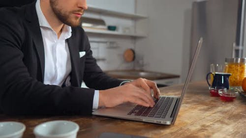 Unrecognizable Man Typing E-mail on His Laptop