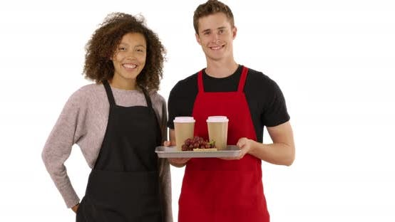 Thumbnail for Portrait of two cheerful waiters wearing aprons on white background