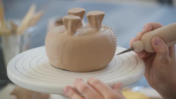 Thumbnail for Woman Decorating Handmade Pottery Vase Close-up