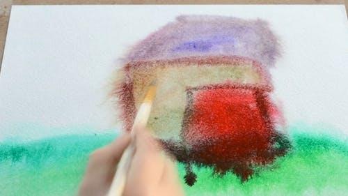 Das Kind zeichnet das Haus