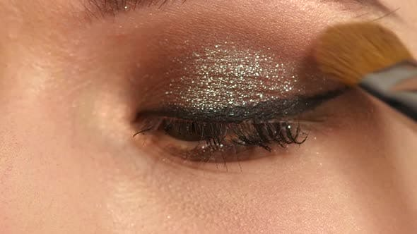 Thumbnail for Girl with Makeup Brush. Close Up. Slow Motion
