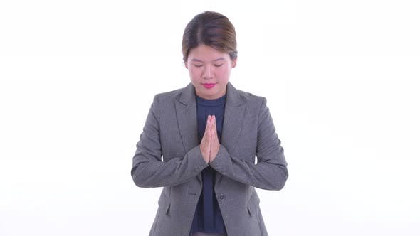 Cover Image for Happy Young Asian Businesswoman Bowing with Respect As Greeting