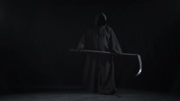 Thumbnail for Horrible Dark Figure In A Hoodie With A Scythe Came To Halloween
