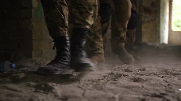 Thumbnail for Soldier Legs in Army Combat Boots Walk in Building