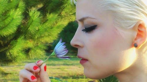 Lady Smells Flower