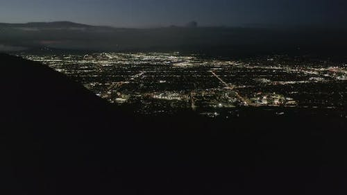 AERIAL Flight Over Hollywood Hills at Night with View on Valley  Burbank and City Lights