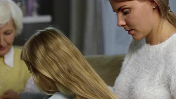 Thumbnail for Loving Mother Brushing Hair of Little Daughter