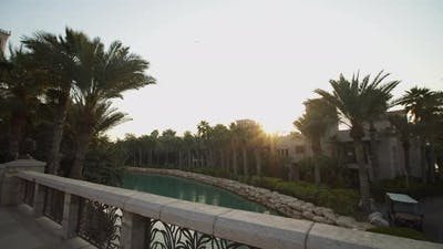 River Inside Tourist Resort with Palm Trees and Hotels in Dubai