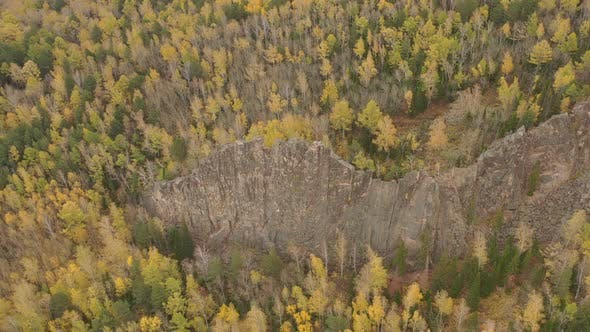 Aerial View of the Rock Among the Autumn Forest.