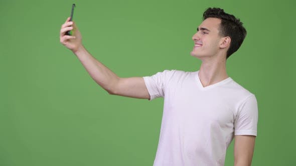 Thumbnail for Young Handsome Man Video Calling with Phone