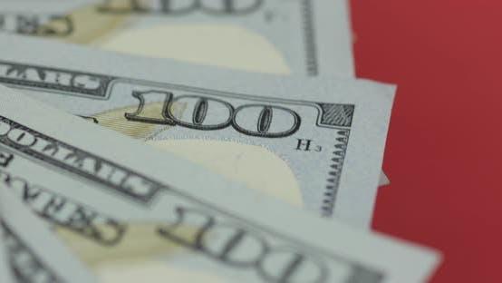 Thumbnail for Hundert amerikanische Dollarscheine drehen. Nahaufnahme. Hintergrund mit Dollarscheine