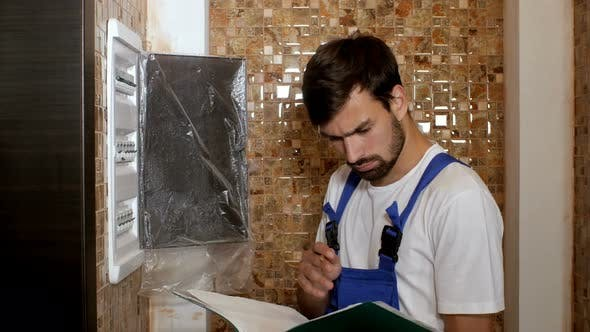 Thumbnail for Young Adult Electrician Builder Engineer Screwing Equipment in Fuse Box