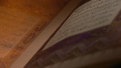 Holy Quran On Book Rest With Prayer Beads