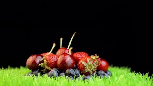 Thumbnail for Pile of different fruits on rotating grass surface