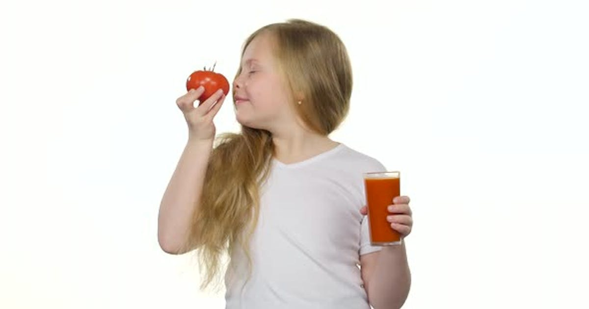 Little Girl Drinks Tomato Juice and Licks Her Lips, White Background