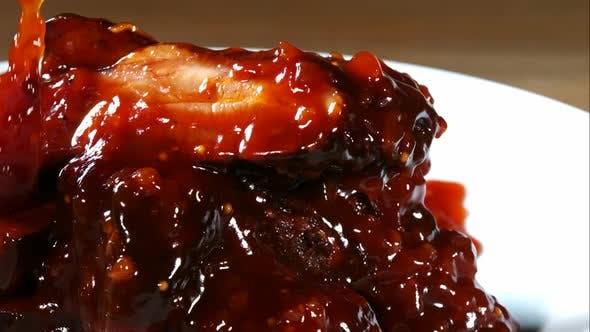 BBQ sauce pouring and splashing in ultra slow motion 1500fps onto BBQ ribs - BBQ PHANTOM 079